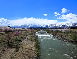 Overlook the Myoko mountain range from the bridge over the Yashiro River